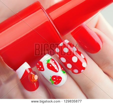 Nail art manicure. Valentines Day Holiday style bright Manicure with painted hearts and polka dots. Bottle of Nail Polish. Beauty salon. Hand. Trendy Stylish Colorful Nails, Nailpolish