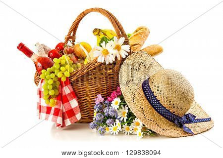 picnic basket with fruit bread and wine isolated on white