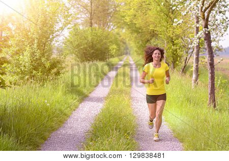 Active Healthy Young Woman Enjoying A Morning Run