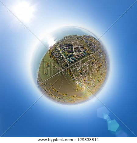 Aerial view of a summer house village at ocean coast. Blue sea. Little planet mode.