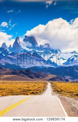 The highway crosses Patagonia and conducts to snow-covered top of Mount Fitzroy. The road through the desert
