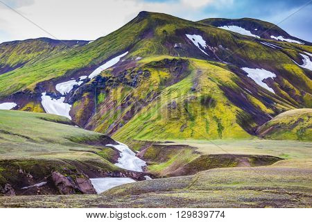 Valley National Park Landmannalaugar. On the gentle slopes of the mountains are snow fields and glaciers. Magnificent Iceland in the summer