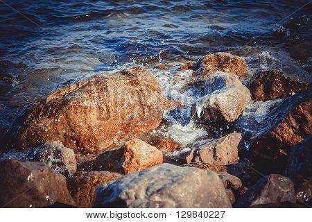 big wet rocks splashing and shining sun filter