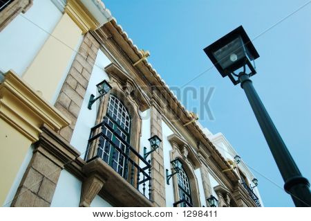 View Of Colonial House And A Street Lamp