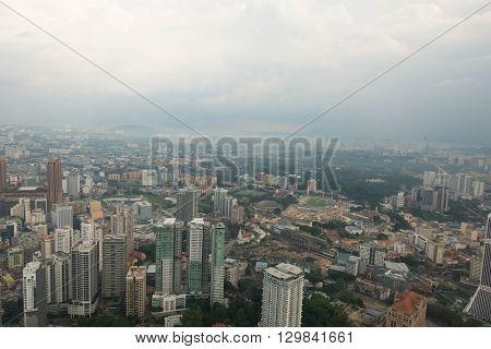 KUALA LUMPUR MALAYSIA - MAY 10 2016 : Kuala Lumpur skyline and other skyscrapers. Aerial view from the Menara Kuala Lumpur Tower.