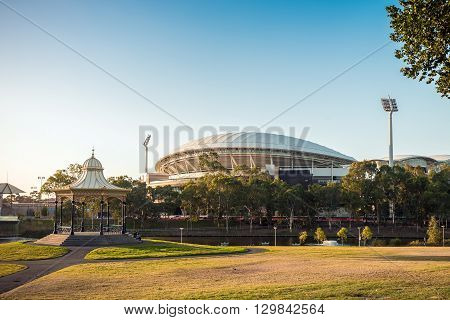 Adelaide Australia - January 3 2016: Adelaide city Elder Park skyline with people sitting near gazebo viewed from King William street during evening