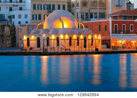 Picturesque view of Venetian quay of Chania with Kucuk Hasan Pasha Mosque during mornng blue hour, Crete, Greece