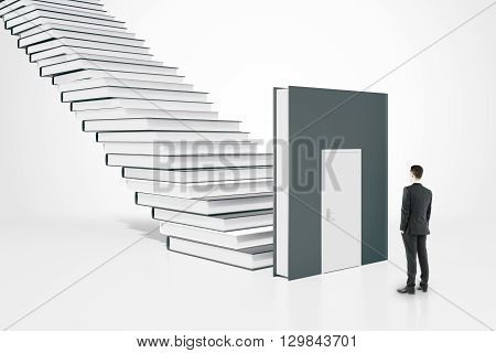 Education concept with businessman standing next to book door and ladder. 3D Rendering