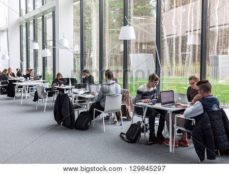 VILNIUS LITHUANIA - APRIL 23 2016: Students sitting and studying at Vilnius University library Lithuania