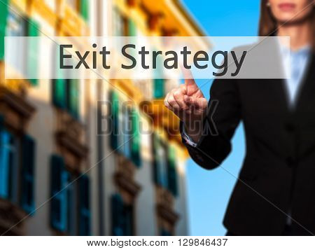 Exit Strategy - Businesswoman Hand Pressing Button On Touch Screen Interface.