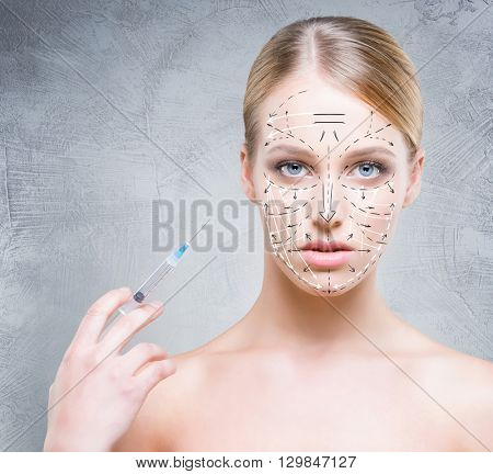 Close-up portrait of young, beautiful and healthy woman ready for a injection. Plastic surgery victim concept.