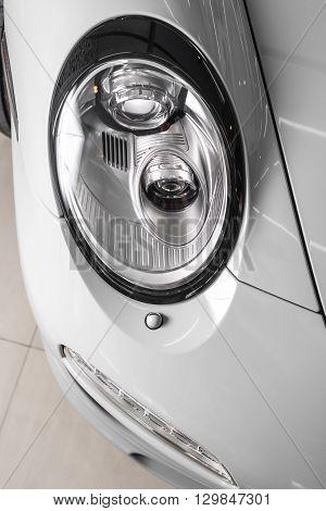 Car detailing series : Closeup of clean gray car headlights