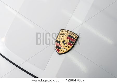 BANGKOK, THAILAND - APRIL 8, 2016 : Closeup of Porsche logo on Porsche 911 sport classic. Only 250 of this model were built.