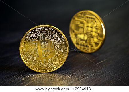 Golden Bitcoins on a wooden table .Photo (new virtual money )