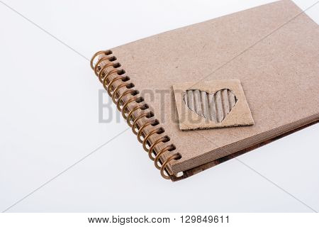 heart shape on the spiral notebook on a white background