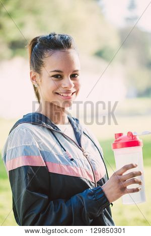 Portrait Of A Hispanic Woman With A Bottle Of Water