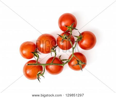 Detail photo of cherry tomatoes on the white background. Vegetables - healthy food. Vibrant colors. Red tomatoes.