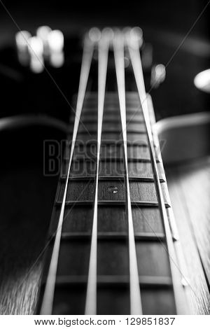 Neck of a classic black bass guitar