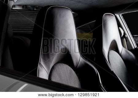 Car detailing series : Closeup of clean two dark leather sports car seats
