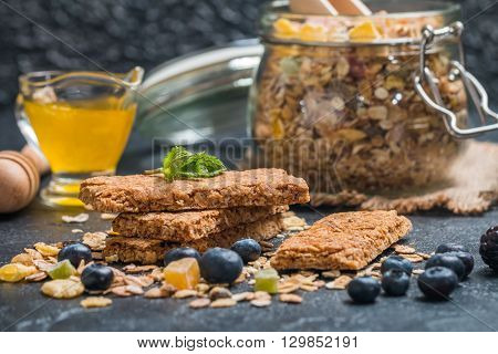 Granola bar from homemade granola with honey on black background