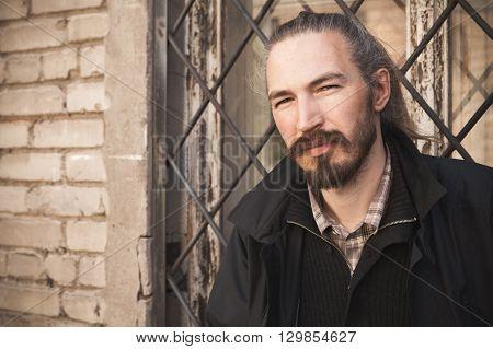 Outdoor Stylized Portrait Of Bearded Asian Man