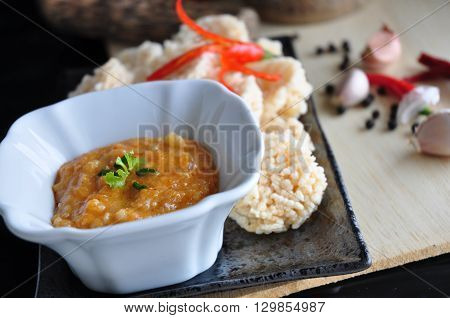 Close up dip sauce on rice cracker dish in Thai style