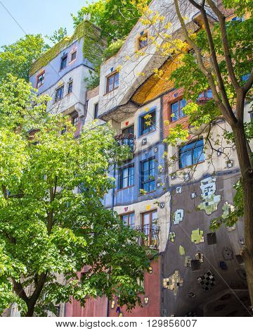 VIENNA AUSTRIA - 8TH MAY 2016: A view of the Hundertwasserhaus during the day in the summer.