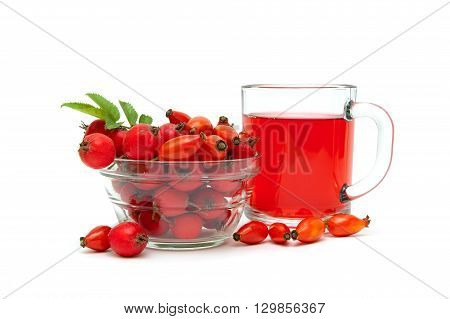 rose hips and hawthorn berries and drink in a cup on a white background. horizontal photo.