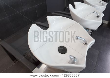 view of three hairdresser washbasins from above