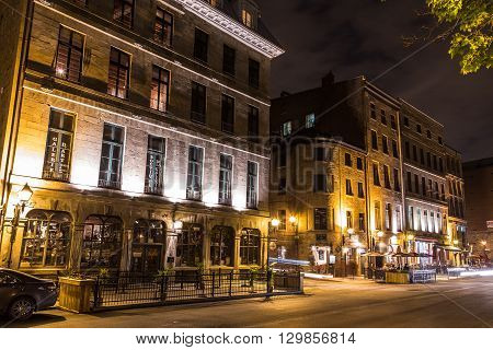 MONTREAL CANADA - 17TH MAY 2015: A view of buildings along Rue de la Commune in Old Montreal at night.