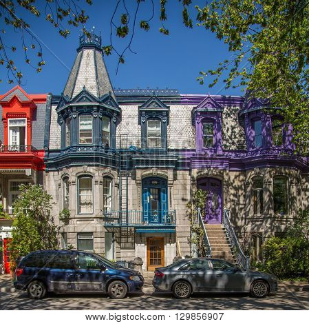 MONTREAL CANADA - 17TH MAY 2015: The outside of colourful buildings at Square Saint-Louis in Montreal