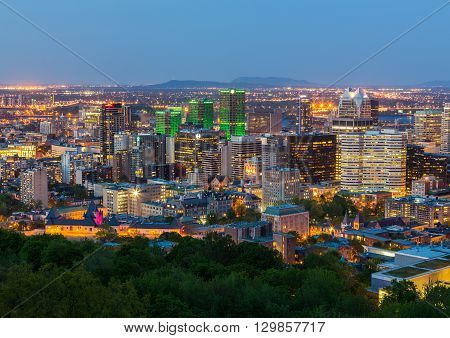 MONTREAL CANADA - 18TH MAY 2015: A view of the Montreal Skyline at Dusk showing various buildings in the city