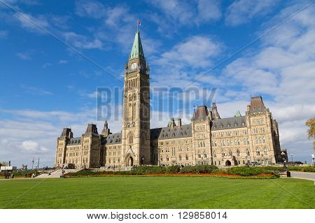OTTAWA CANADA - 11TH OCTOBER 2014: The houses of parliament in Ottawa from the distance. People can be seen outside