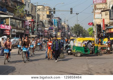 DELHI INDIA - 19TH MARCH 2016: Roads and streets of Delhi during the day. People on bikes Tuk Tuks and pedestrians can be seen.