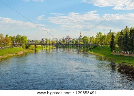 View of the River Tvertsa, bridge and monastery in the ancient Russian city of Torzhok