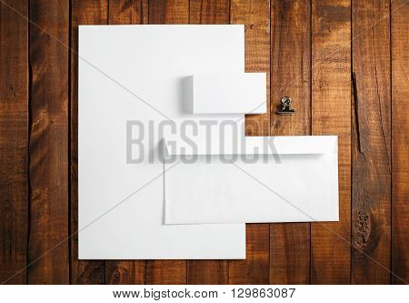 Blank stationery mock-up. Blank stationery and corporate identity template on vintage wooden background. For design presentations and portfolios. Top view.