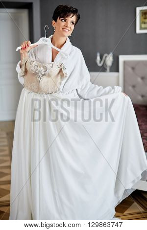 young beautiful woman dresses wedding dress morning bride