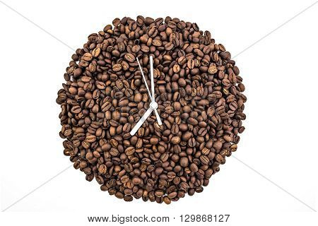 Clock of coffee grains isolated on white background. Clock pointed at seven o'clock