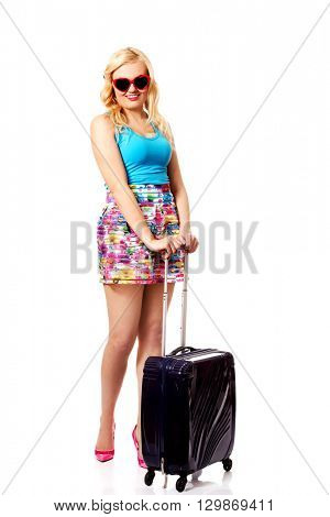 Smiling young woman with wheel bag