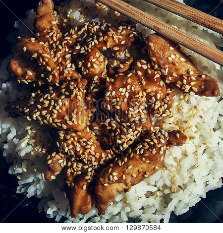 Chicken teriyaki with steamed rice. Square crop.