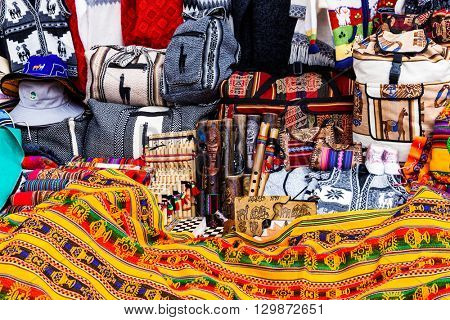 peruvian souvenirs and bags on the market