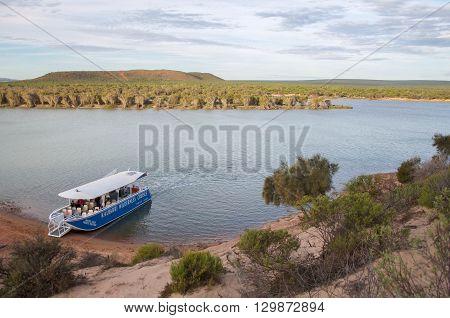 KALBARRI,WA,AUSTRALIA-APRIL 18,2016: Elevated views over the Murchison River landscape with river cruise boat in Kalbarri, Western Australia.