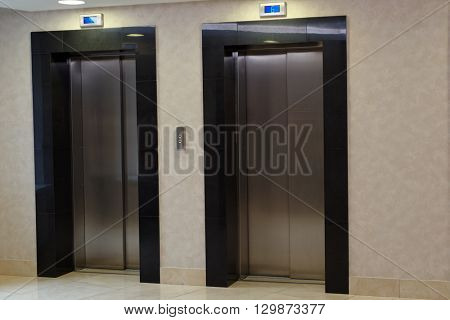Doors of two elevators in the apartment building