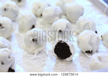 Sweet chocolate cake balls covered in white chocolate