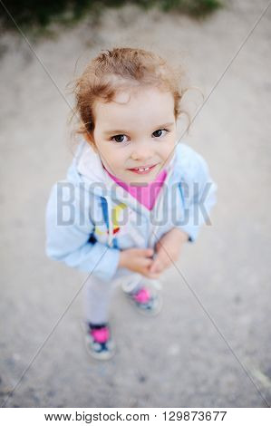 little girl with beautiful white teeth smiling at the camera