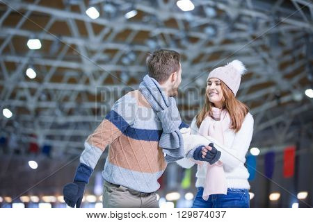 Young couple at skating rink