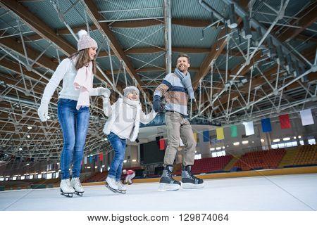 Happy family at skating rink