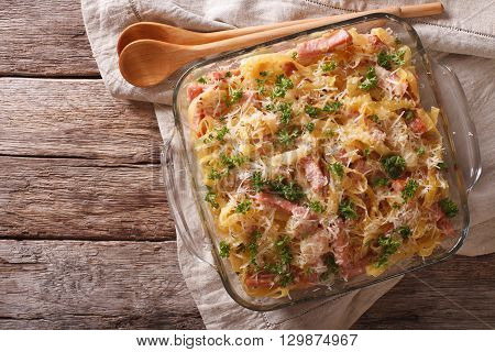Noodles Baked With Ham And Cheese Close-up In A Baking Dish. Horizontal Top View