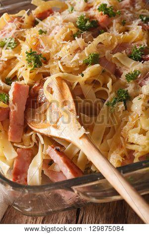 Austrian Cuisine: Schinkenfleckerln Macro In Baking Dish. Vertical