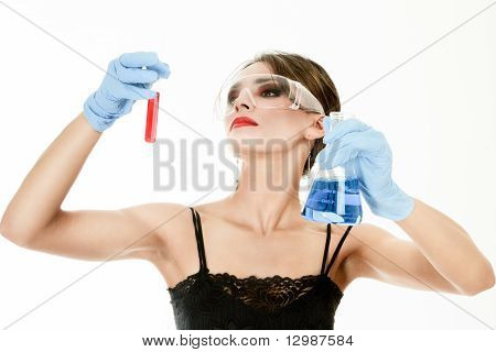 Young Woman Holding Test Tubes In Hands